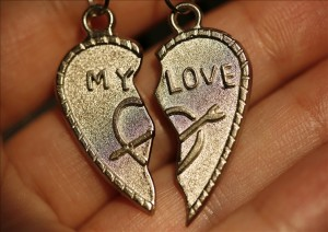 "Two half of heart with an inscription ""My love"""